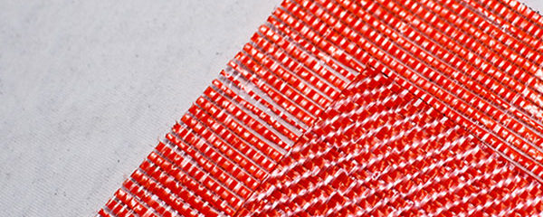 orange netting fabric installation